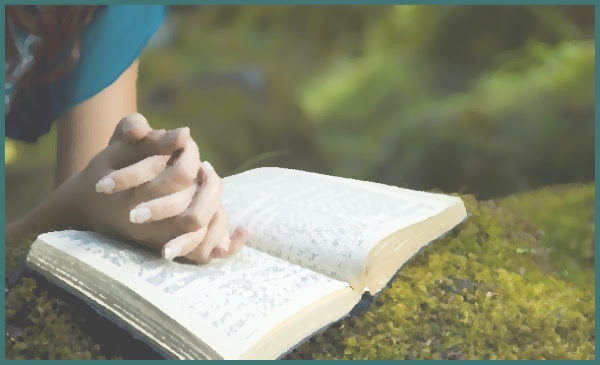Woman discerning religious life while praying with Bible